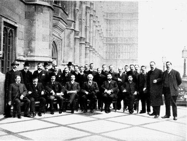 The first Parliamentary Labour (Socialist) Party gathered on the terrace of the House of Commons, London, 1906. Ramsay Macdonald is seated third from the left, then Arthur Henderson and next to him, Keir Hardie