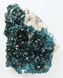 Blue-green dioptase crystals in groundmass, close-up