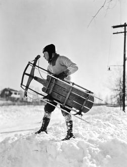 A Boy Carrying His Sled
