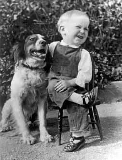 A Boy Laughs With His Dog