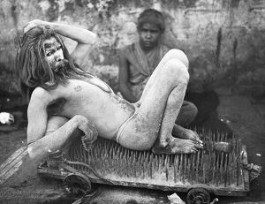 Calcutta, Hindu beggar resting on a bed of spikes