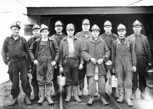 Coal miners at the entrance of a mine