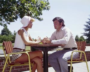 Couple sitting at a table outdoors