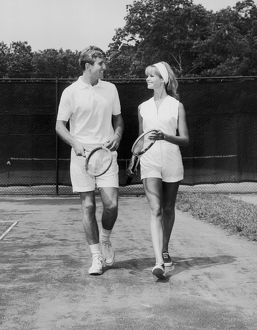 Couple on the tennis court