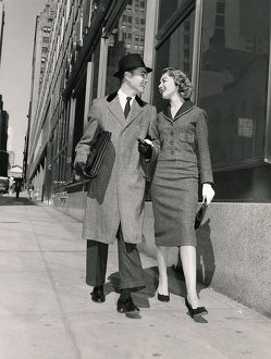 Couple walking on city street