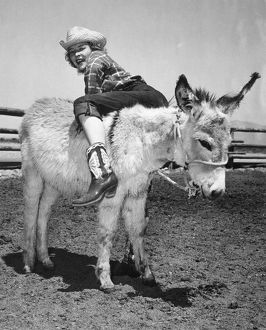 Cowgirl Backwards On A Donkey