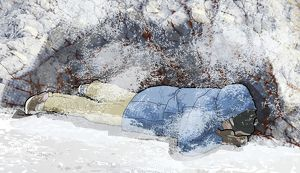 Digital composite of man lying on front in snow covering face with hands sheltering