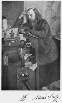 Dmitiri Ivanovich Mendeleyev (1834-1907), Russian chemist. Working at his desk