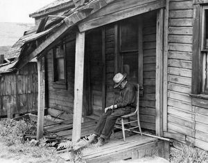 Elderly Man Doses On His Porch
