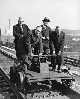 Executives Commute By Handcar