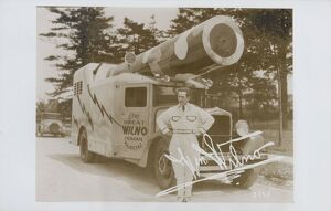 The Great Wilno. ca. 1935, USA, The Great Wilno, a human cannon ball, stands beside