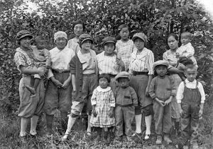 A group of first generation Japanese immigrants gathered at a garden club meeting
