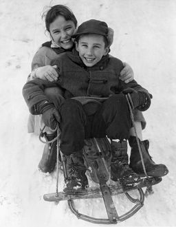 Happy Children On A Sled