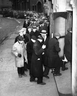Men waiting on bread line during the Depression