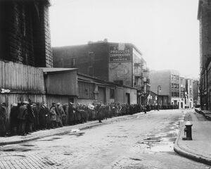 Men waiting on a bread line, New York