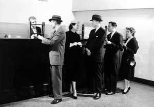 People waiting in line at bank