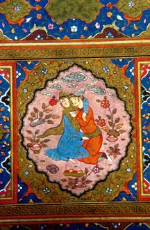Detail from Persian manuscript depicting lovers embracing in garden, surrounded by