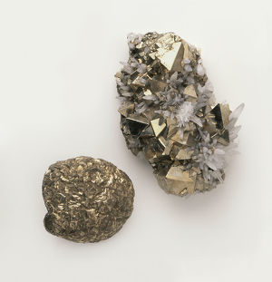 A piece of octahedral pyrite interspersed with quartz crystals, and a piece nodular pyrite