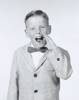 Portrait of boy calling out wearing a bow tie