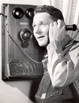 Portrait of a man using a telephone