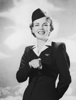 Portrait of stewardess pointing
