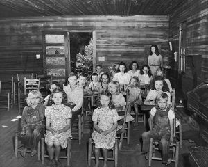 Pupils and teacher in one-room schoolhouse, Kentucky