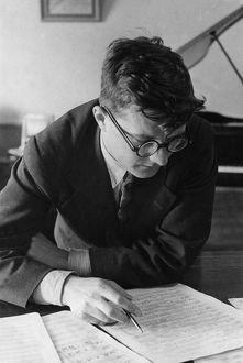 Soviet composer, dmitri shostakovich, working in his study, 1938.