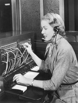 Telephone operator working at switchboard