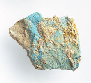 Turquoise on rock surface, close-up