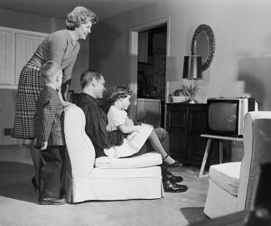 Vintage image of family watching television