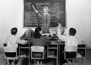 Vintage image of teacher at blackboard