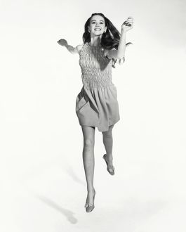 Vintage portrait of a young woman jumping