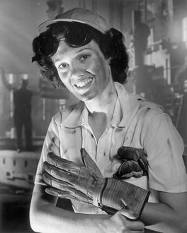 Woman wearing hard-hat, gloves and goggles