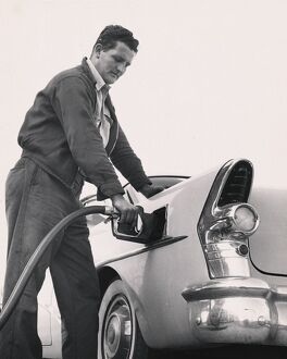Worker pumping gas into a Buick