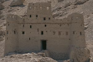 Yemen, Hadhramaut province, traditional mud brick building on sid eof mountain