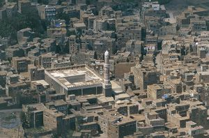 Yemen, Hadramawt, Shibam, town of mud brick houses with mosque, elevated view
