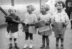 Four Young Children Singing